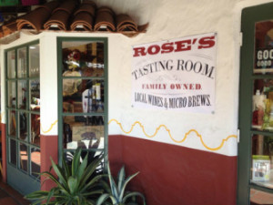 Roses Tasting Room Local Wines and Microbrews Sign